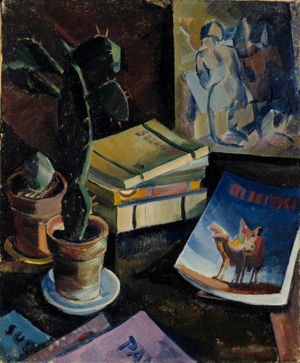 painting of books, two cactuses and a painting on a table